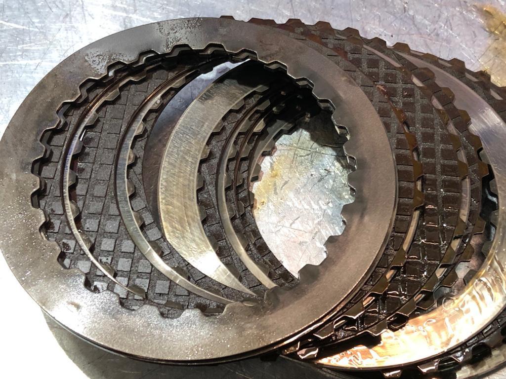 сгоревшие фрикционные диски стартового пакета вариатора Ауди 01J